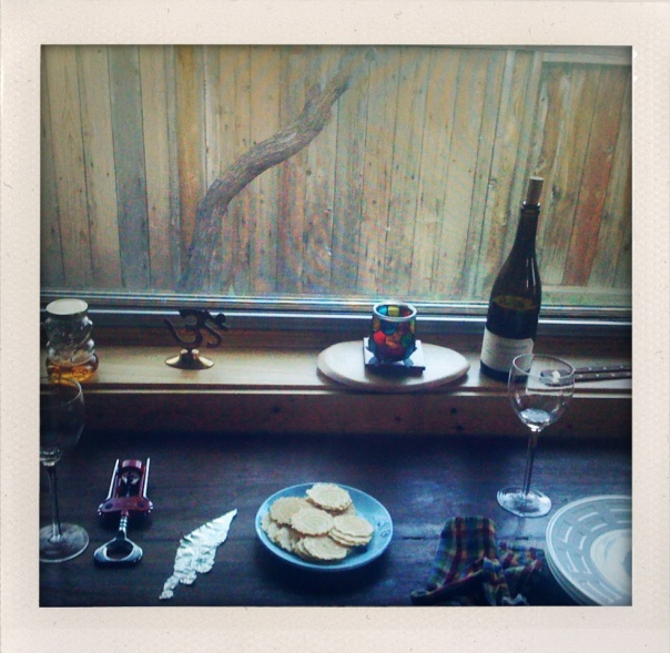 window with wine & crackers by Katie Heath